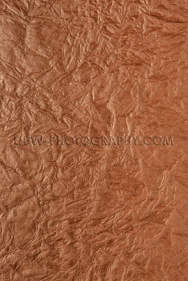 Dark brown wrinkled texture structured background full frame XXX