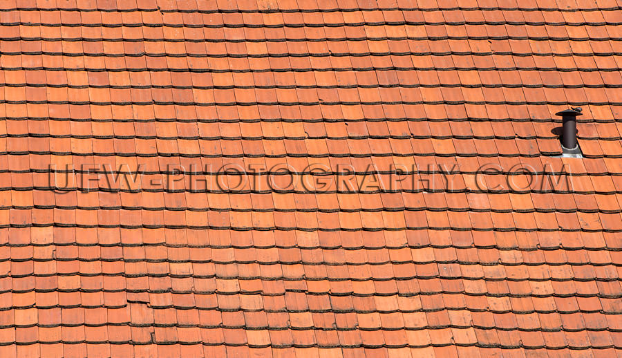 Red shingled roof old house country full frame background Stock