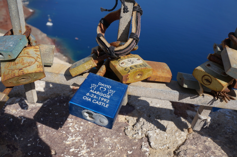 Santorini has its own version of a love lock bridge - not a bridge but a gate located in an area of historic ruins.