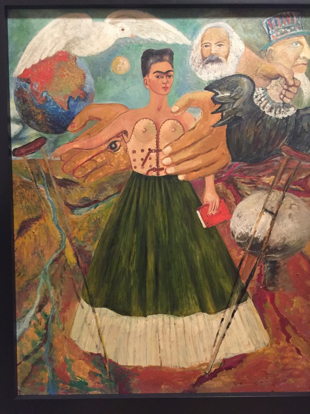 WHILE MANY ARTISTS AT THE TIME FOCUSED ON PAINTING GRAND MURALS, MANY OF FRIDA'S WORKS WERE SELF PORTRAITS THAT CONVEYED HER SELF REFLECTION