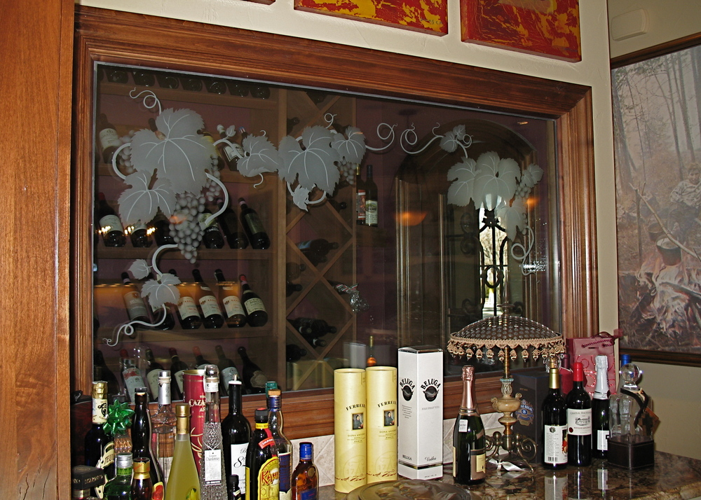 Custom etched glass cabinets