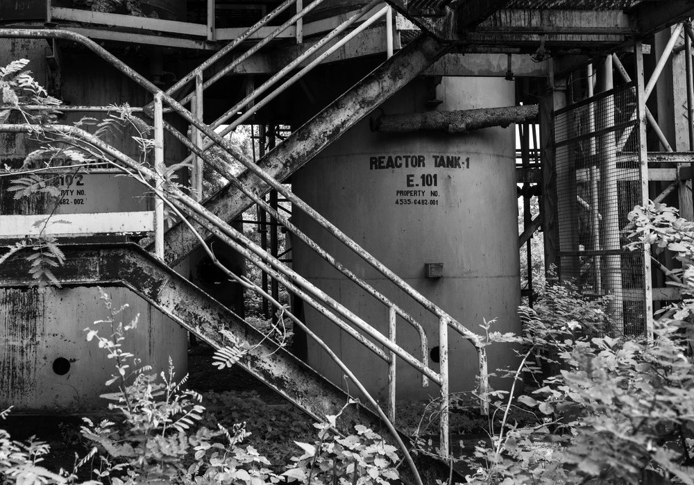 Surrounded by overgrown trees, rusting reactors sit inside the abandoned UCIL factory in Bhopal, India. In 2001, US based corporation Dow Chemical purchased Union Carbide, inheriting it's assets as well as it's liabilities. Both Union Carbide and Dow Chemical have consistently declined to compensate the victims, remediate the site, and provide safe drinking water to the neighborhoods they contaminated. They have resisted the disclosure of the composition of the toxic release in the 1984 gas disaster, hindering the accurate diagnoses and treatment of those exposed.