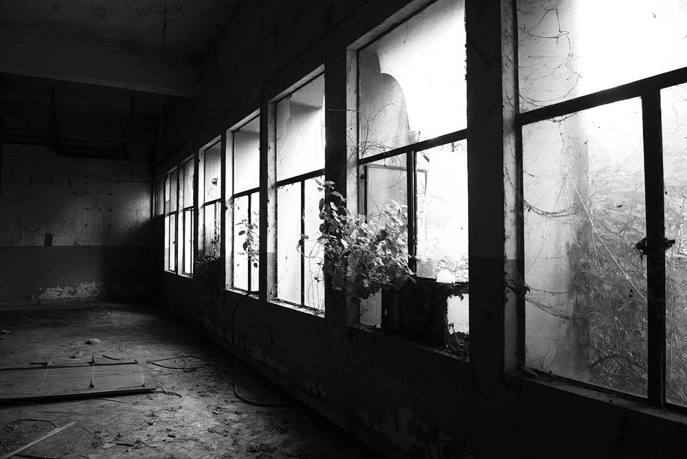 An vacant building that contained chemical stockpiles until a recent clean up is located in the abandoned Union Carbide factory in Bhopal India. The 1984 MIC gas leak at the Union Carbide factory in Bhopal killed over 8000 people, making it the biggest industrial disaster ever. Toxic material from the past factory operations and the defunct plant continues to contaminate soil and groundwater in the vicinity, impacting the health of many.