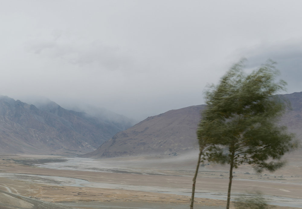 During harvest season, storm clouds loom over the village of Kumik in Zanskar, Kashmir. Climate change is resulting in non-seasonal precipitation in the form of rain in the high desert of Zanskar region, posing a threat to the crops, harvested grass and the centuries old adobe mud dwellings. All this has significantly shaken the foundation of autarky lifestyle.