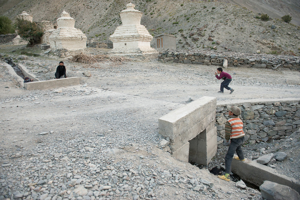 Children play by the Kumikthu stream in the village of Kumik, in Zanskar, Kashmir. In the summer of 1998, the stream, the village's only source of water dried up completely due to climate change. Since then the village has been facing a water scarcity, further challenging their means of livelihood such as farming and raising livestock.