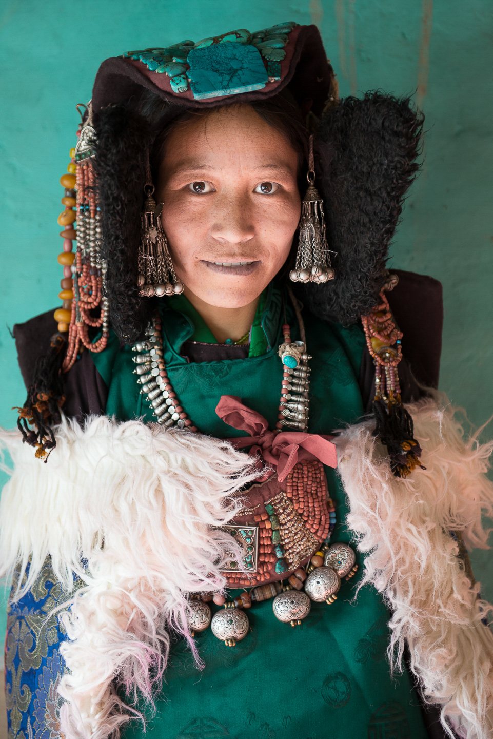 Stanzin Dayskon poses for a portrait wearing traditional Tibetan regalia. People in the village are of ethnic Tibetan-Mon origin and practice Tibetan Buddhism. Zanskar has remained isolated from the world for centuries and continue to live in in autarky. Over the centuries Zanskar has had zero population growth due to the traditional practice of polyandrous marriage where women take in multiple men as partner. However, the practice has died in the last few decades.