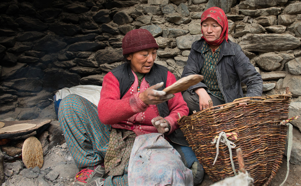 Soman Chasdon (left) and her daughter Lobzan Tsamo(right) make traditional flat bread on a dung-fired stove at their home in the village of Kumik,  in Zanskar, Kashmir. Many homes, including Chasdon's, have adapted CNG gas stove for cooking. They help improve indoor air quality and reduce emission of soot that contributes to global warming. A vast majority of homes in the region use them only to make soups or tea because CNG cylinders are cost prohibitive and many do not have the means to transport them.