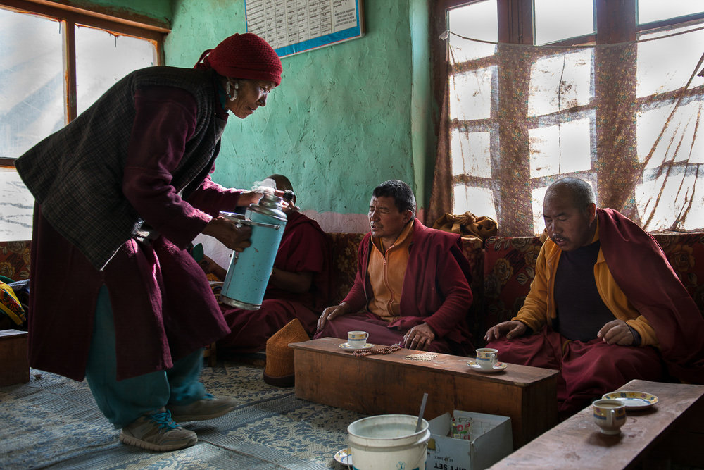 Padma Tolkar serves traditional Tibetan butter tea to Buddhist monks offering prayers at the village temple (Gompa) in Kumik. Villagers pay the monks for their services in the form of monetary support and food supplies. When monks are unavailable to perform prayers and rituals, nuns get asked to take over. Most monasteries in Zanskar are wealthier than nunneries.