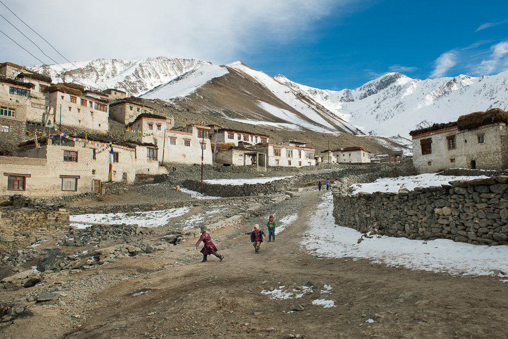 On a warm winter day in January, children play in the village of Kumik in Zanskar, Kashmir. In the Zanskar region, winters have always been severe, with temperatures dropping to almost 40 below Fahrenheit and a snowpack that sat on the ground until June, but climate change is making winters warmer. Kumik received a scant snowfall in the 2016 winter. Villagers faced water shortage in the year ahead, impacting both agriculture and livestock rearing.