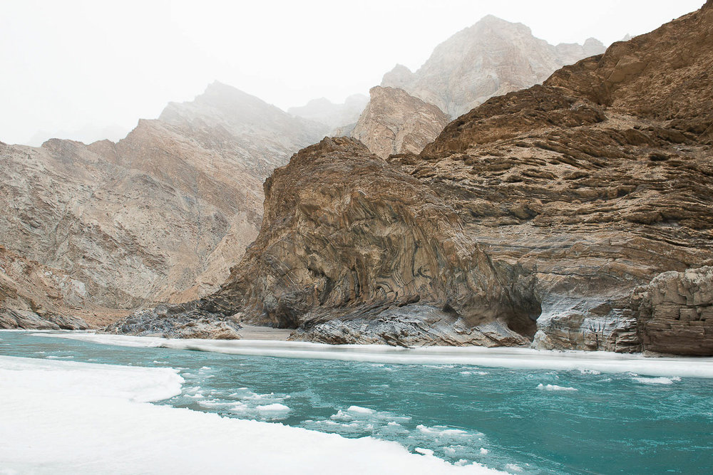 "During winter, the Zankar River in Kashmir that is supposed to remain frozen completely thaws due to unusually warmer temperatures. The Zanskar region, formerly a part of western Tibet, is a remote mountainous area in Kashmir that remains isolated from the world except in summer. The only winter '""road"" out of the valley is the frozen Zanskar River. People of Zanskar region have always trekked a distance of over 100 kms on the frozen river in sub-zero temperatures, at an altitude 12,000 feet, to get medical attention or to trade. Due to climate change the river no longer freezes completely, making the several day journey during winter months treacherous and life threatening."