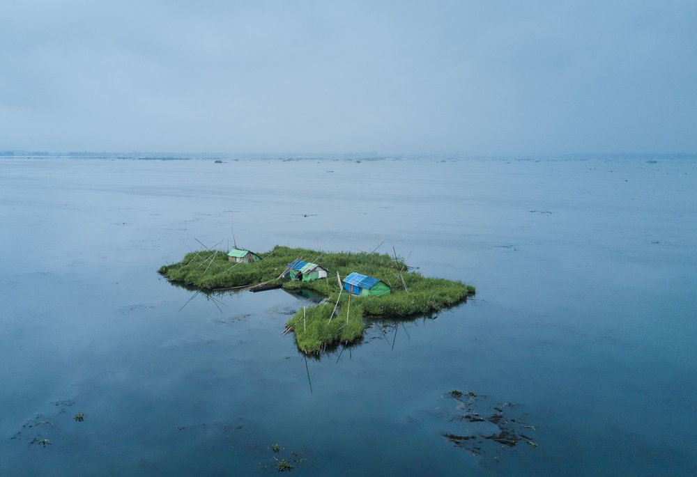 A view of Phum Shangs (floating huts) inside Loktak Lake, Manipur. The Loktak Development Authority (LDA) has dredged most Phumdis (floating biomass) and Phum Shangs in the name of lake cleanup.
