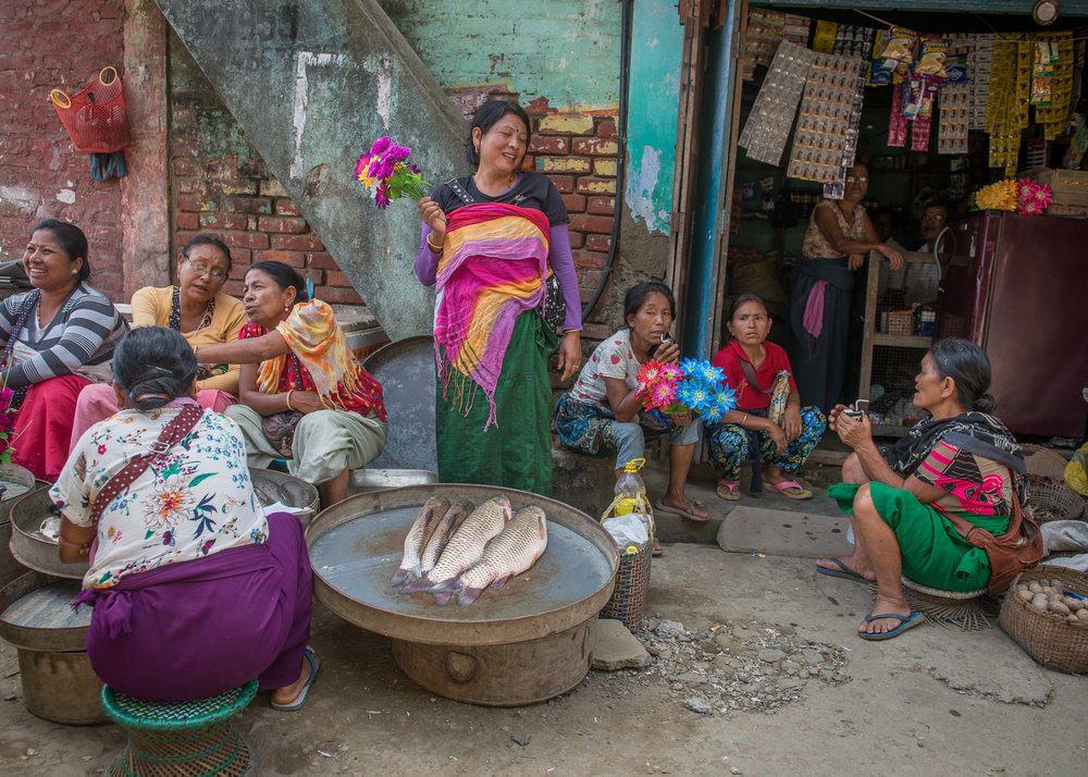 Fisherwomen and vegetable vendors wrap up business for the day in the Ema market in Ningthoukhong, in Manipur. Recurrent floods during monsoon season continue to impact fisheries and vegetable harvest in the area. In August 2017, the state Chief Minister Biren Singh formally urged Prime Minister Narendra Modi to consider the decommissioning of the Ithai Dam as a permanent solution to the ecological disaster.