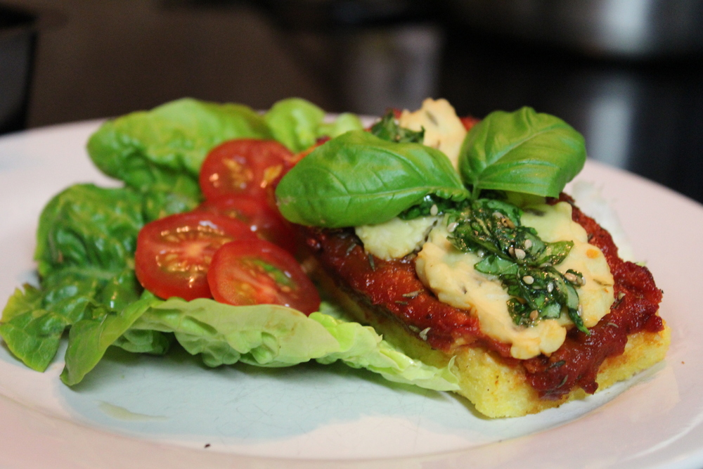 Polenta pizza with cashew cheese and raw tomato sauce