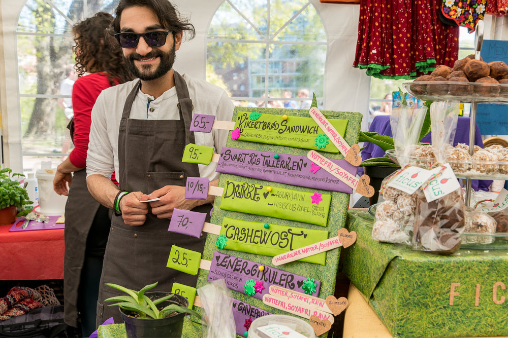 Aryan, selling food at the vegetarian festival in Oslo, 2016.  Stand designed and decorated by Pernille Wester