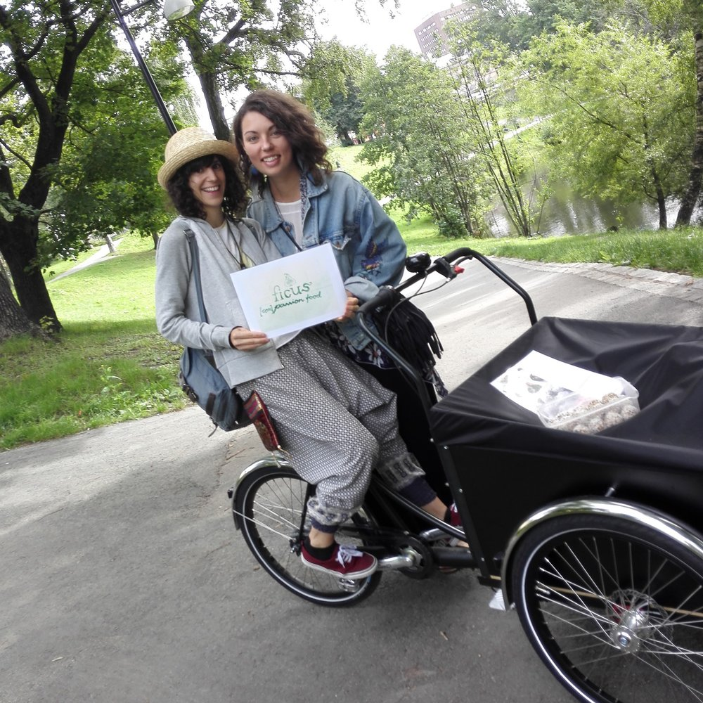 Franchesca, who now gives yoga and meditation classes, and I with a bike we borrowed from Greenpeace. Our first logo was drawn by Adrian Rørheim, who now works at the Foundation for Effective Altruism in Berlin.