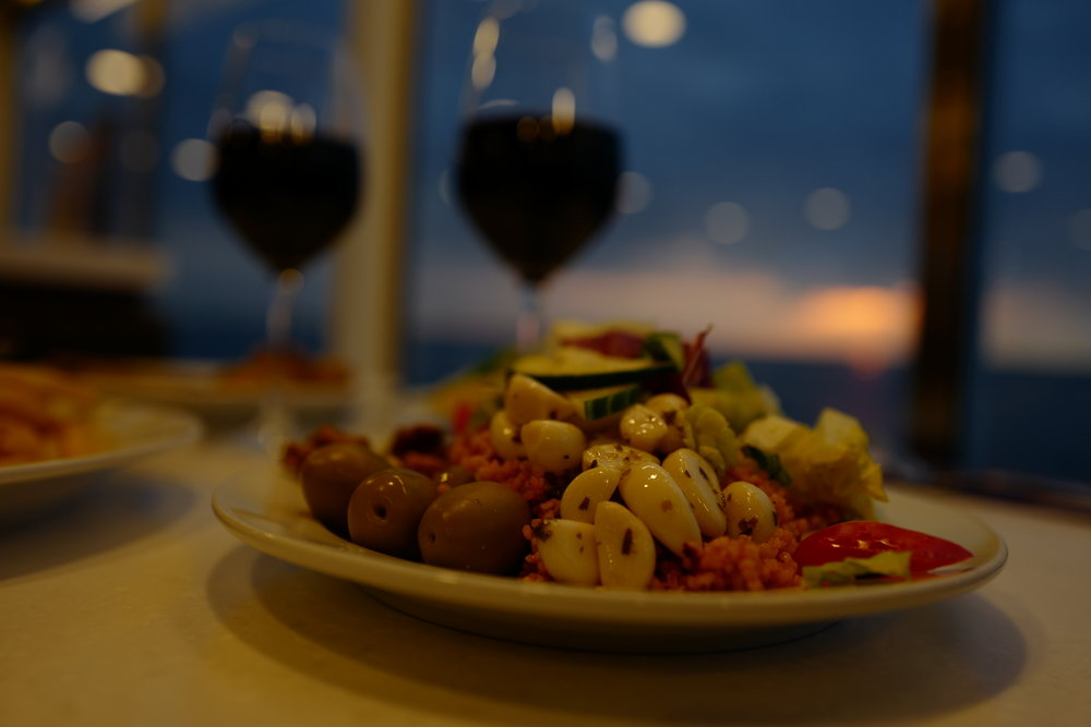 Ferry buffet: We got some couscous over there, vegetables and wine, and a sunset so it's all good.