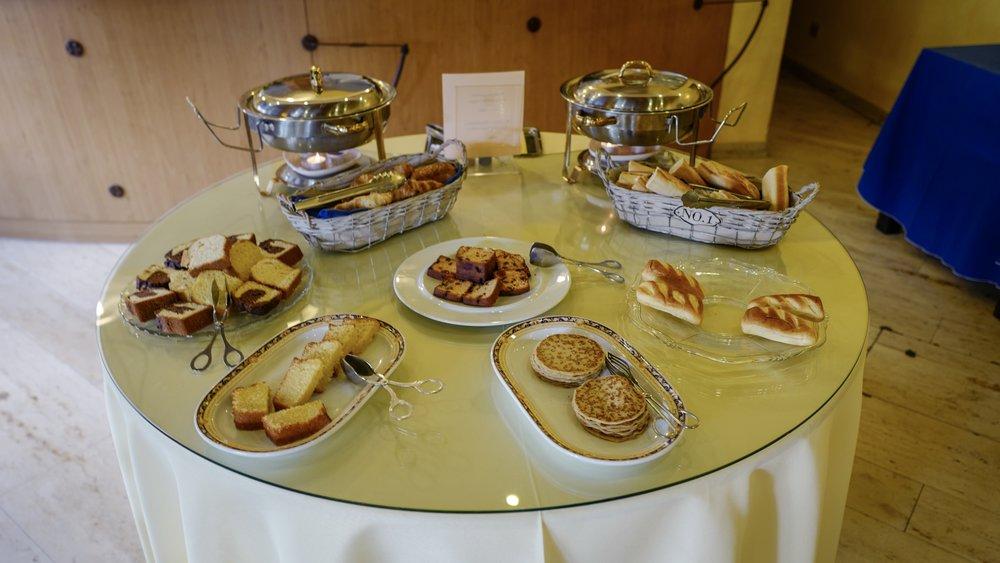 Cake, croissant, cake, pancake, baguette, bread, cake, cake, cake.