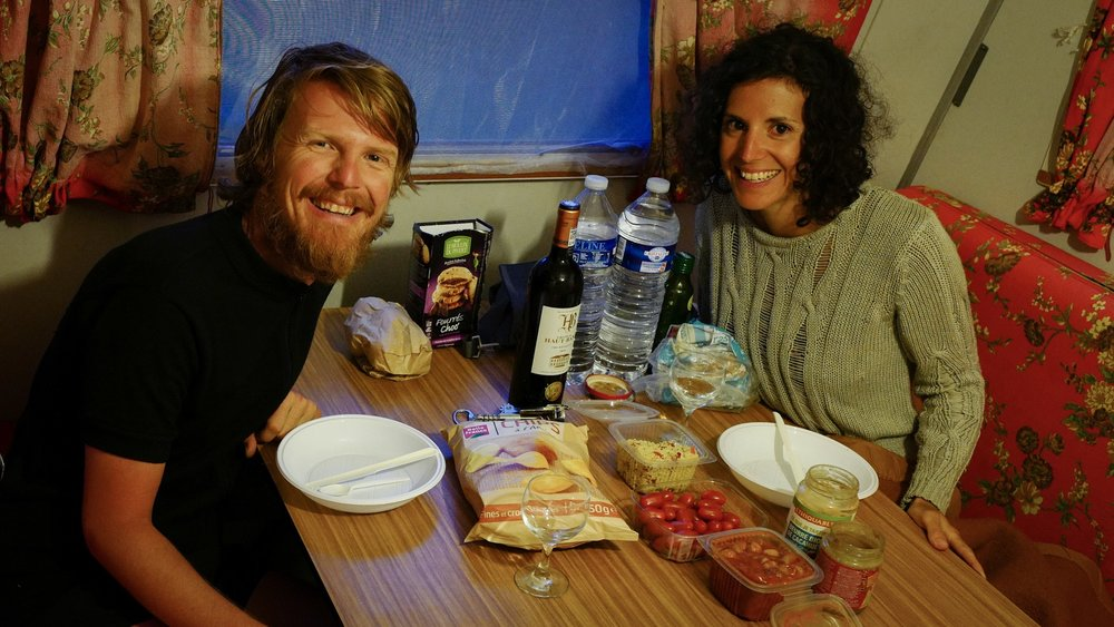 Having a lovely dinner inside the wagon after a 112 km ride! We found some tabouleh, fresh cherry tomatoes, champignons on tomato sauce, wine and chips in the nearest small village where the store people were so kind to keep the store open and helped us find what we needed when we arrived there late.