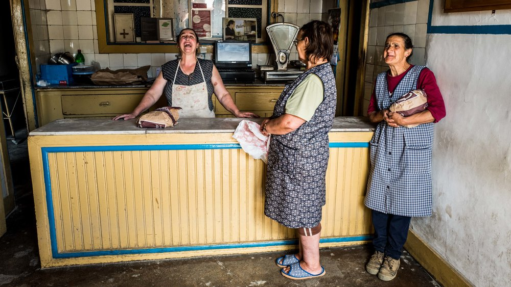 Laughing ladies at the most traditional bakery in Portugal.