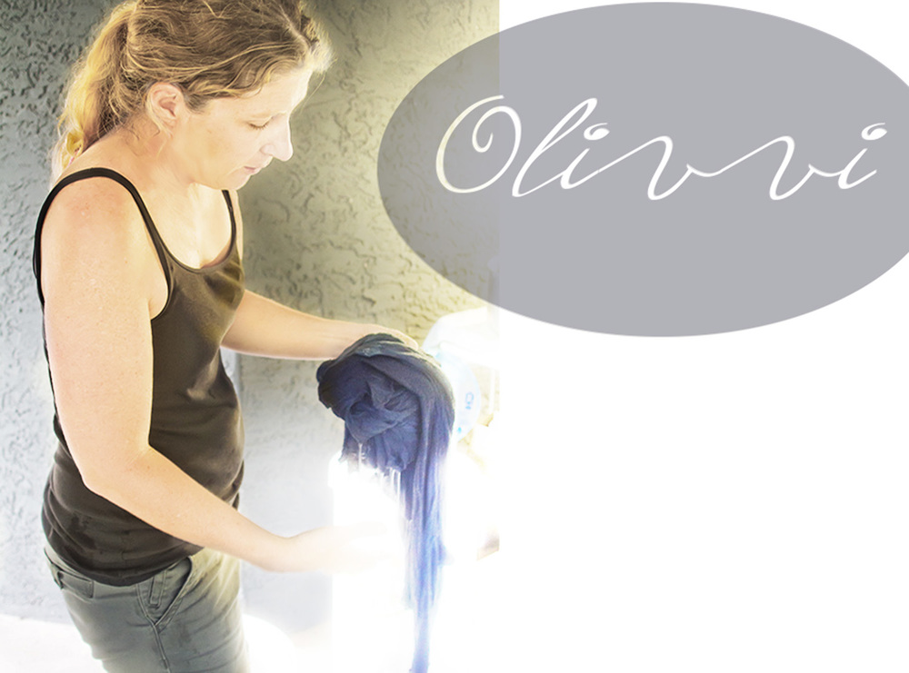 Olivvi owner, Cindy Taylor, hand dying a sweater
