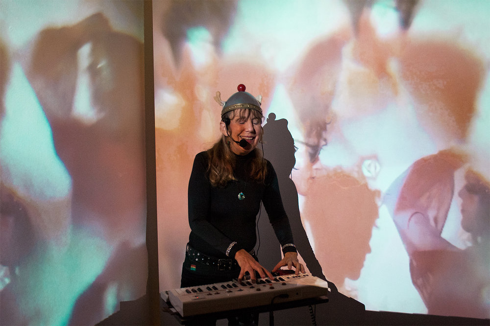 The Space Lady playing inside my video installation at DATELINE Gallery in Denver, CO.