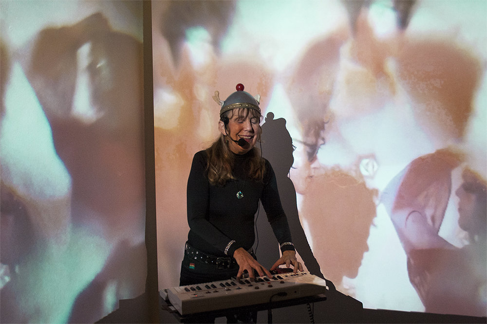 The Space Lady playing inside the installation during opening at DATELINE Gallery in Denver, CO