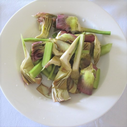 two trimmed & sliced artichokes