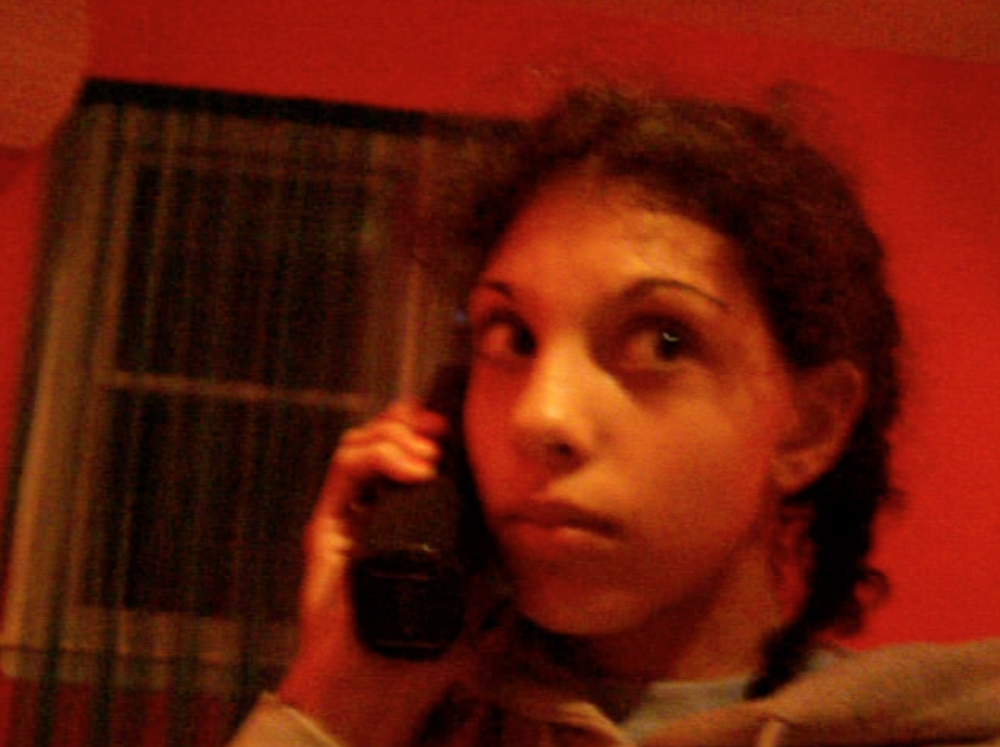 A still frame from a babysitting thriller (starring me and filmed by one of my friends) showcases my classic pensive-eye look. Also note slightly frizzed hair and cordless dinosaur phone...ah, the old days.