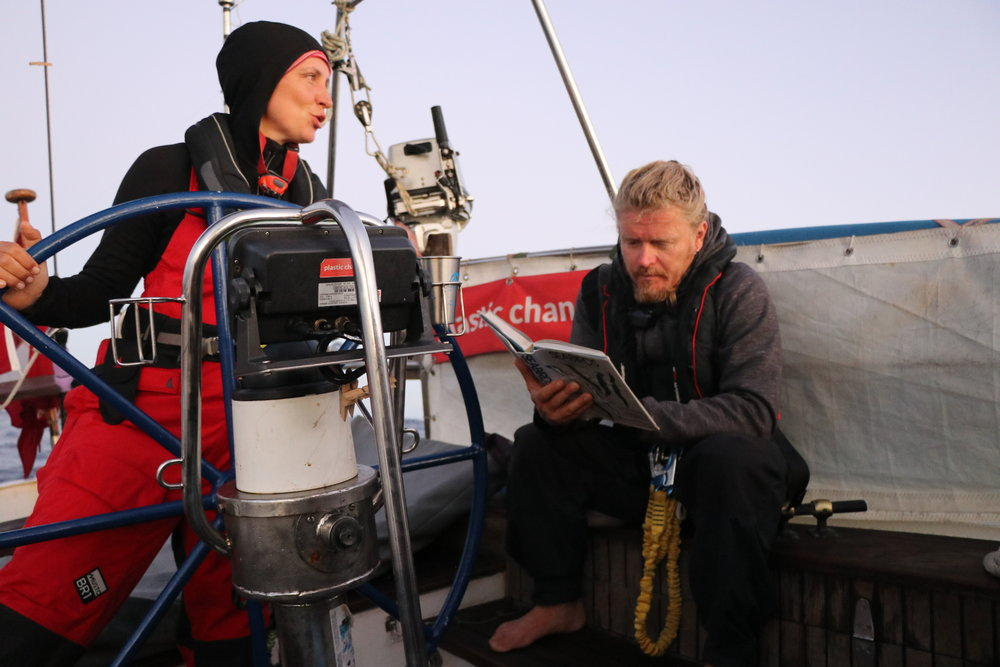 Malene Møhl and Torsten Geertz bird watch from the cockpit of S/Y Christianshavn. ©Erica Cirino