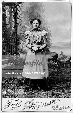 846-02795963em-1890s-1900s-TURN-OF-THE-CENTURY-FULL-LENGTH-PORTRAIT-OF-YOUNG-GIRL-STA.jpg