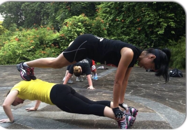Attempting a plank tower at Fort Canning bootcamp training.