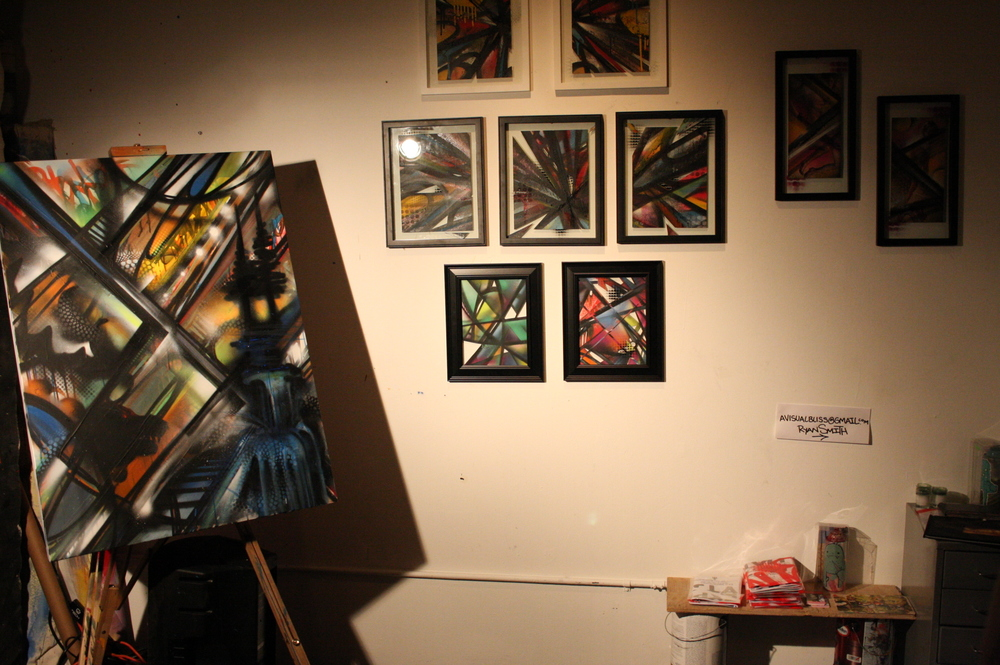 Artist Ryan Smith live piece on the left and his framed works for sale on exhibition on 1.9.15