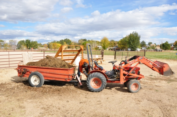 Compost spreaders can have different methods of driving the manure out of the spreader - some operate on their own and can be pulled by a truck, and some can be hooked to a tractor and driven by the tractor's PTO.