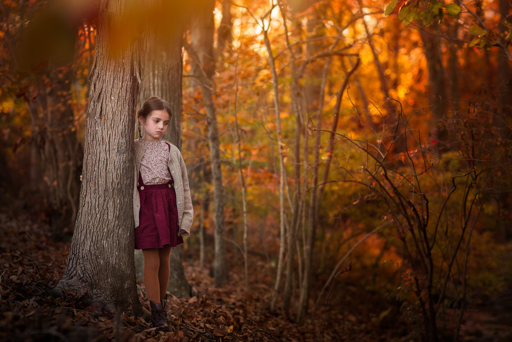 Photographic portrait of a child, photographed on location in Maryland in the fall by Clare Ahalt Photography, a fine art portrait photographer located in Maryland, serving clientele in the Northern Virginia, Maryland and Washington DC Areas.  Specializing in child portrait photography.