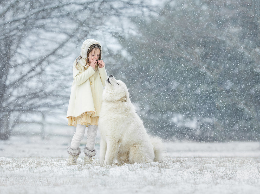 Portrait of a child and dog singing and howling together