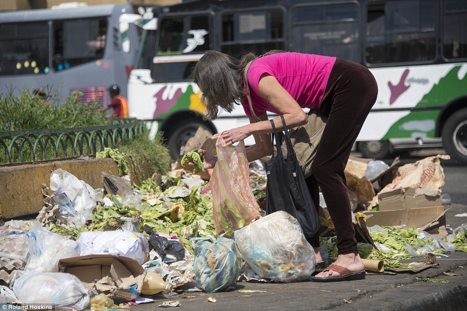 Venezuelan middle class search through garbage for food amidst crisis.