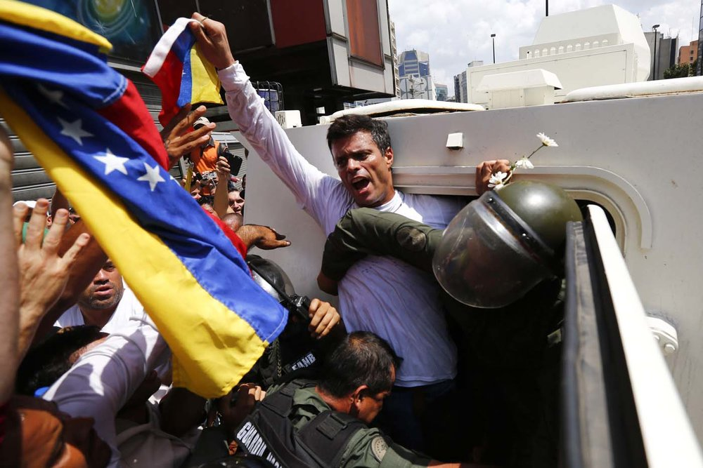 "Leopoldo turns himself to Venezuela authorities in February 2014. ""The options I had were leave the country, and I will never leave Venezuela!"" Lopez told the massive crowd. ""The other option was to remain in hiding, but that option could have left doubt among some, including some who are here, and we don't have anything to hide."""