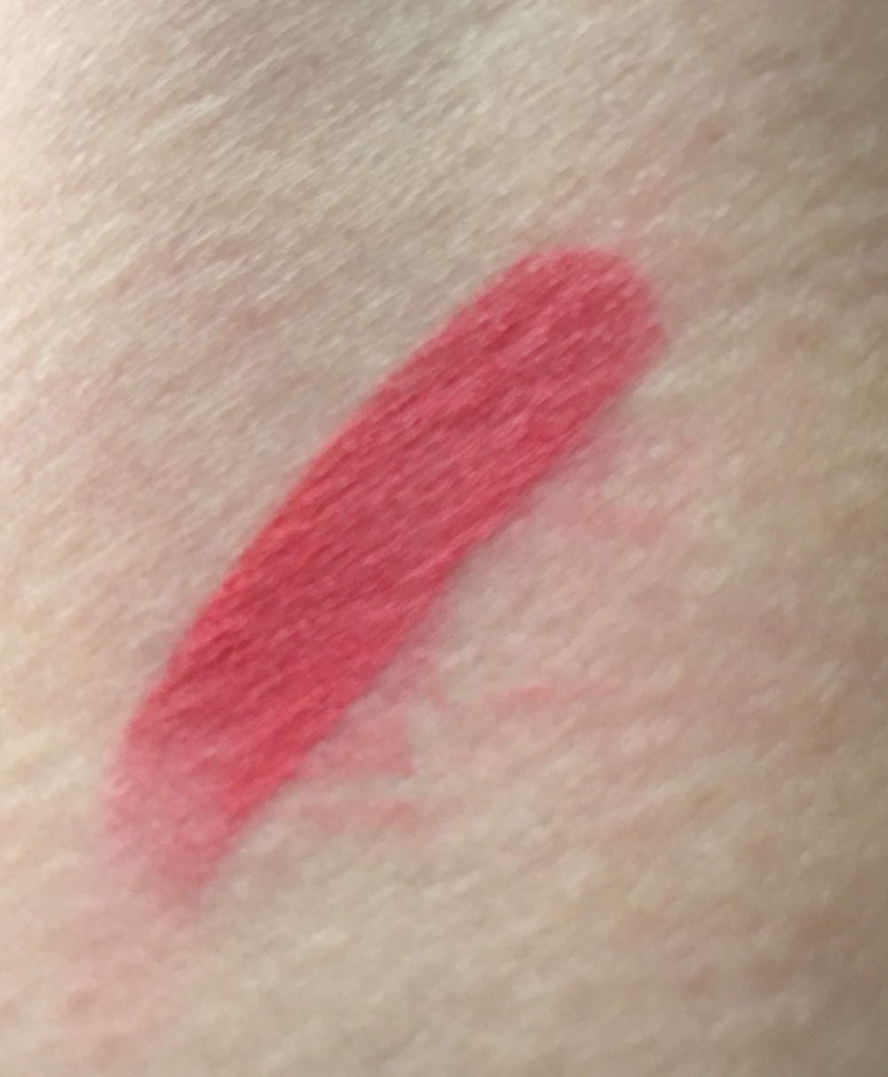 Swatch of glo minerals Suede Matte Stick in Punch.