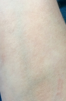 Swatch of Amor Naturals Bella Glow Oil after being blended into my skin