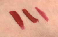 Swatches of RealHer I Am Fabulous Lip Kit in Deep Red, left to right: Matte Liquid Lipstick in I Am Tough Royal Red (True Red), Lip Plumping Lip Gloss in I Am a Fighter, and Lip Liner in Be Yourself Be RealHer
