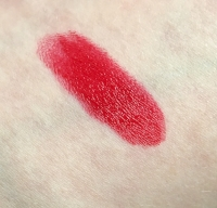 Swatch of 100% Pure Fruit Pigmented Pomegranate Oil Anti-Aging Lipstick in Poppy