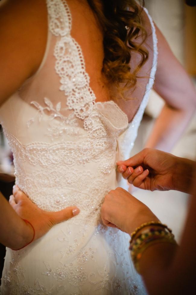 bride getting dresses