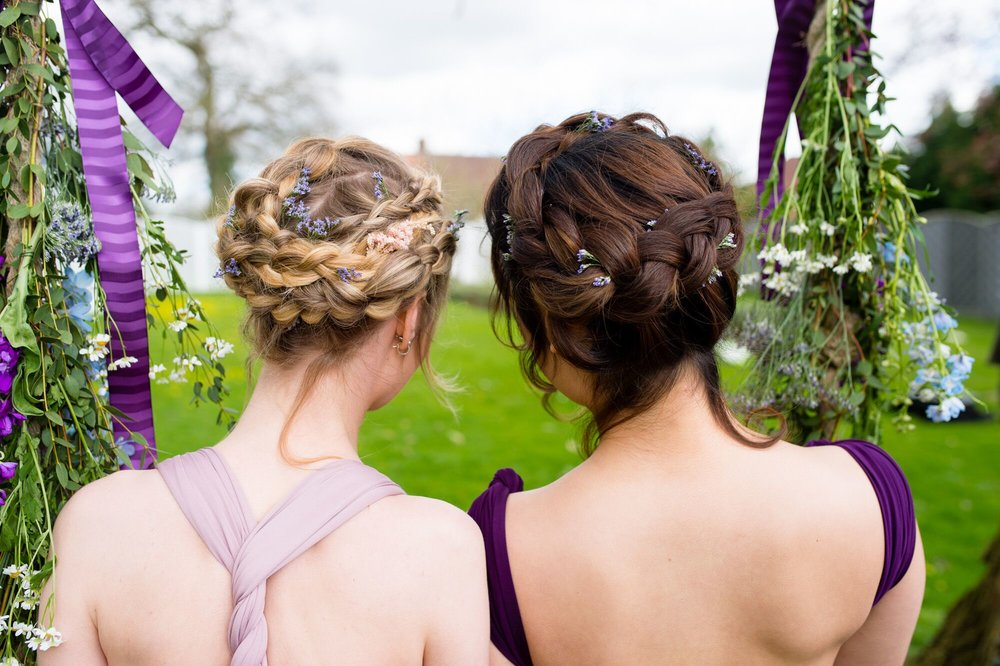 Loose and textured updo's are a popular option for 2018. Who needs tiara's when you can wear a braided crown. Hairstyle is by Bridal Hair by Sharni Knighton.