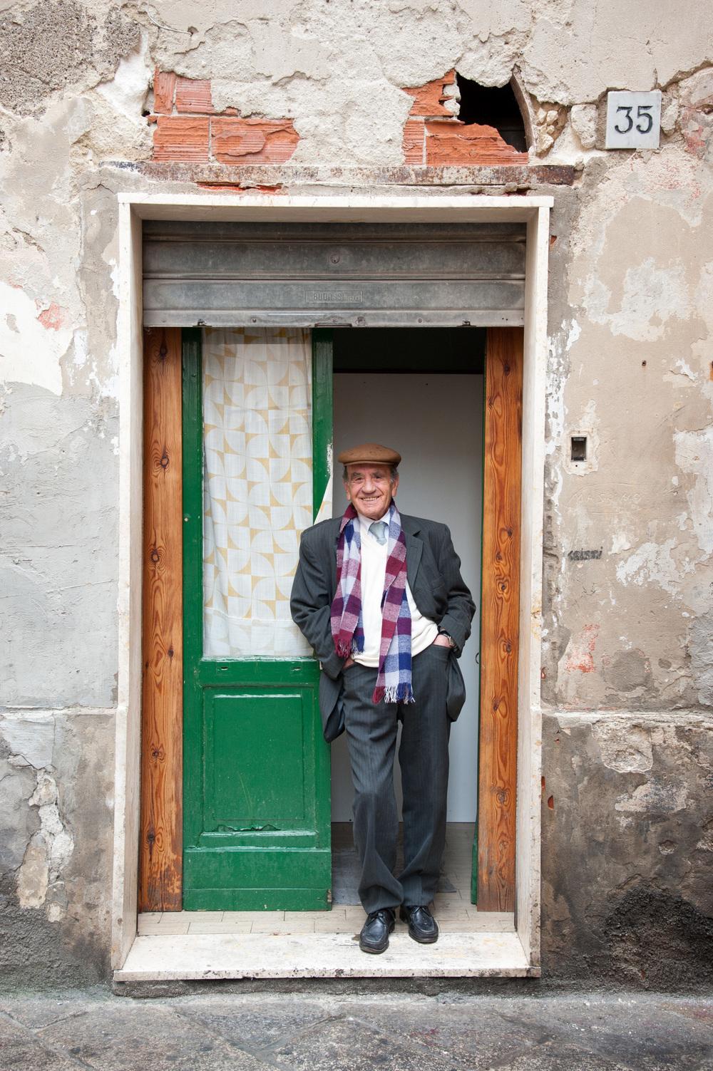 Barber on his shop doorstep, Sassari, Sardinia
