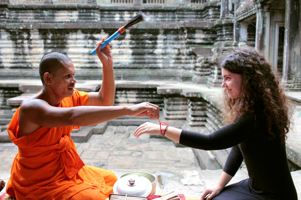 Receiving a monk's blessing in Siem Reap, Cambodia.
