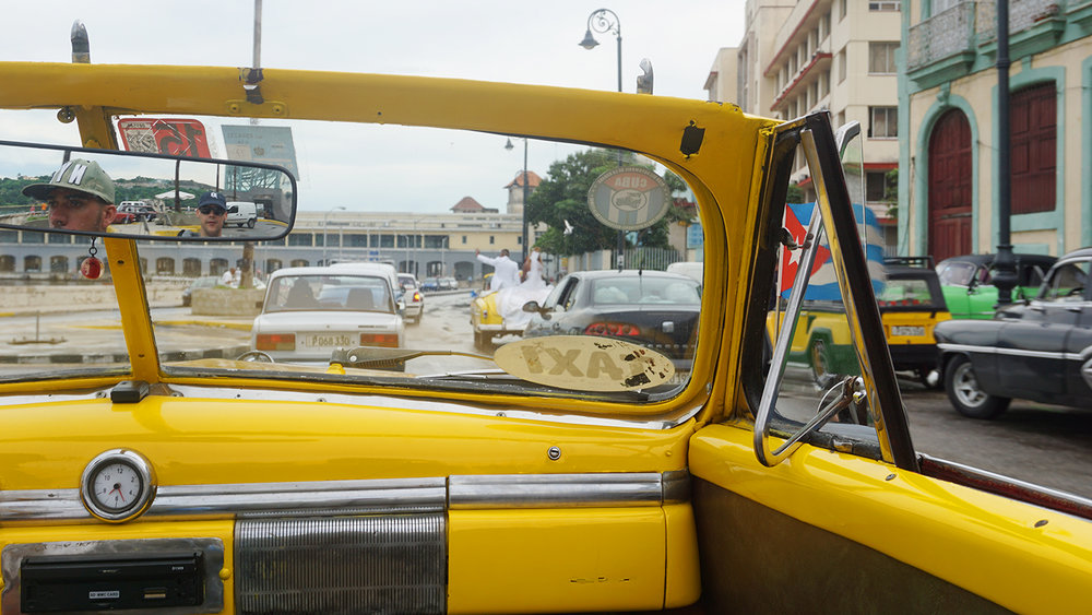 Taking a ride in a classic car, Havana