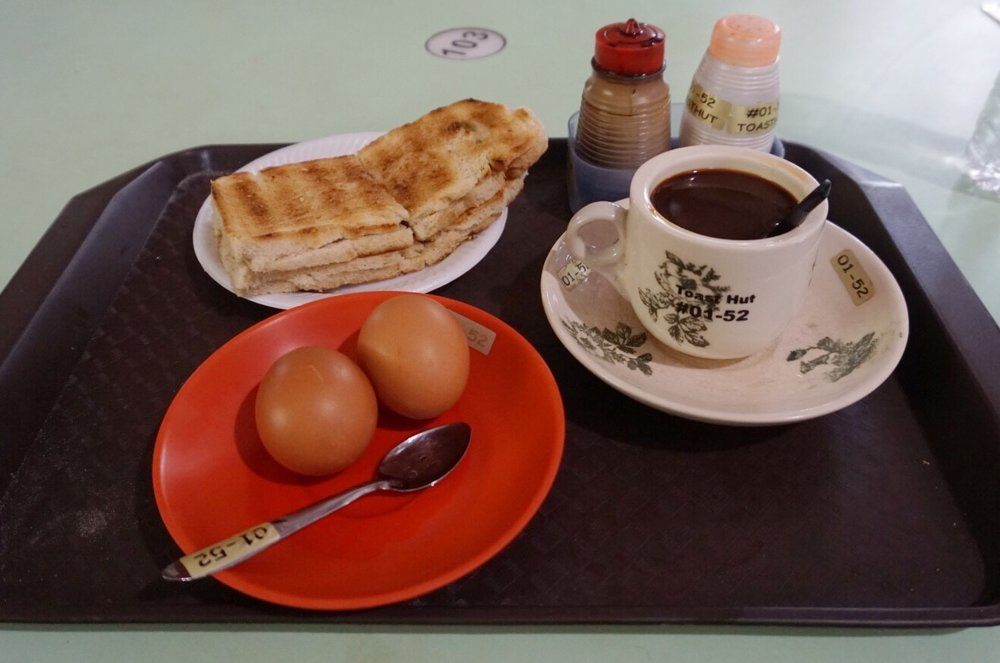 Kaya toast, soft-boiled eggs (careful, they're nearly raw), and coffee with condensed milk - a very sweet breakfast!