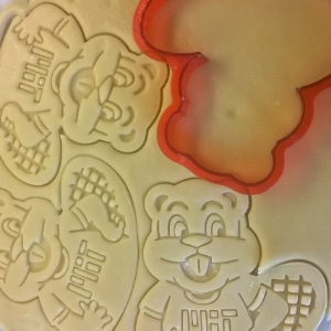 Use your cookie cutter to cut shapes and press designs right onto the dough before baking.