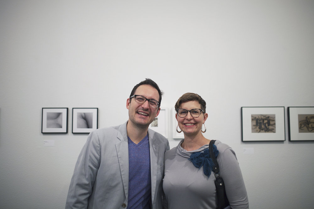 scott b. davis and a lovely lady at the opening reception. (A glimpse of my lumen prints on the right side.) Photo Credit: © Lisa Kimberly