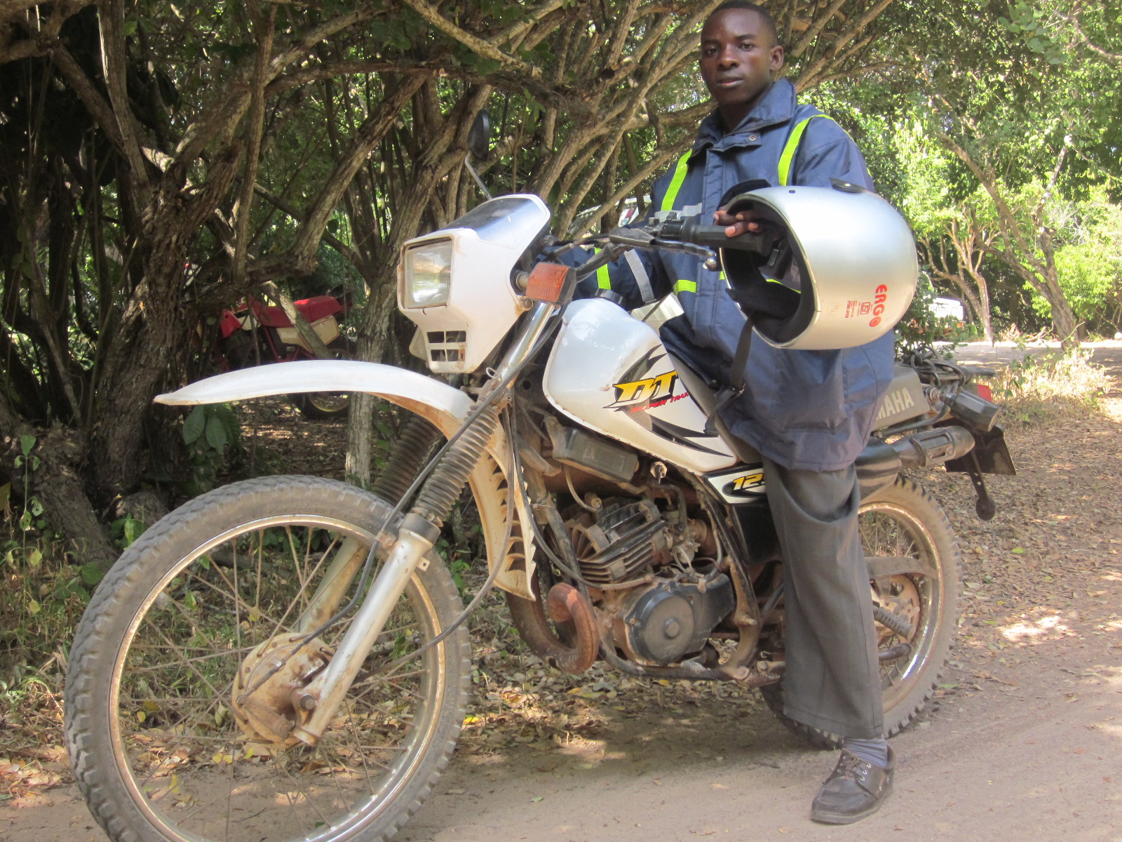 Bimbo, a member of A Rocha's ASSETS team, on his motorcycle dispatching the bursary cheques to the ASSETS students
